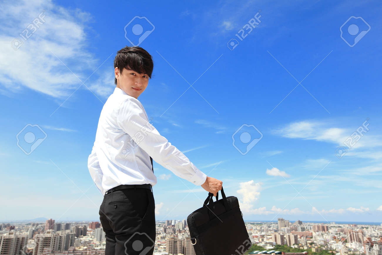 Successful handsome business man with blue sky and city background, mode is a asian male Stock Photo - 22144606