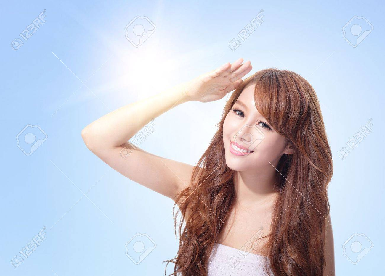 Beautiful woman face with sunshine and blue sky, concept for skin care and sun block, asian beauty Stock Photo - 23833478