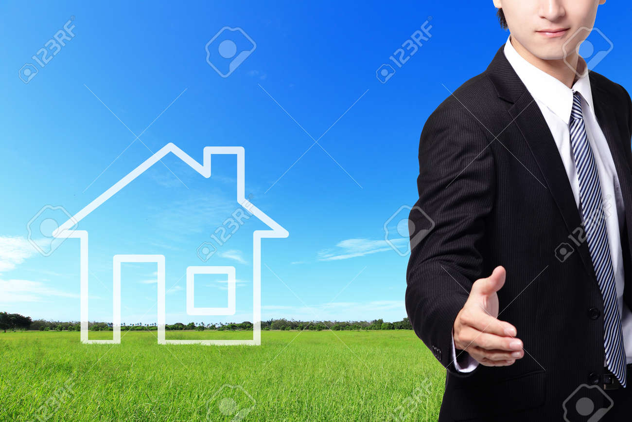 businessman handshake, welcome gesture, with New house imagination vision on green meadow. Real estate Concept Stock Photo - 24325861