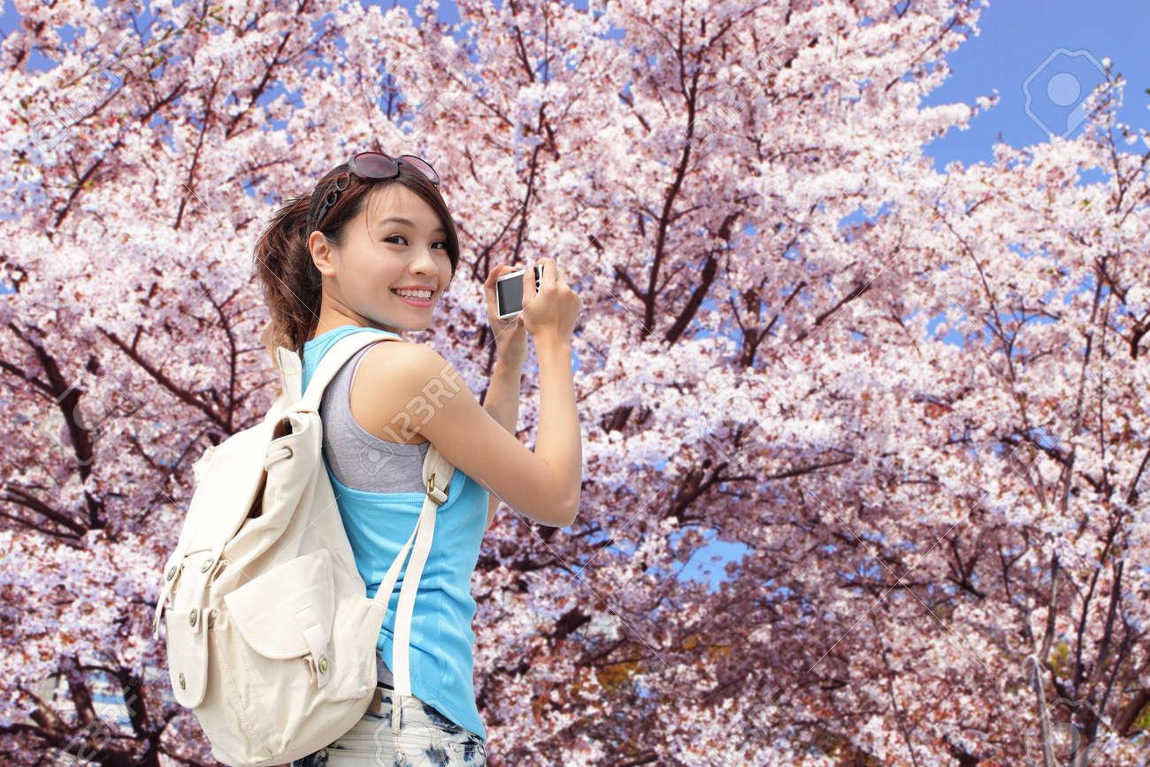 Happy Woman Traveler Photo By Camera With Sakura Tree On Vacation - Vacation in japan