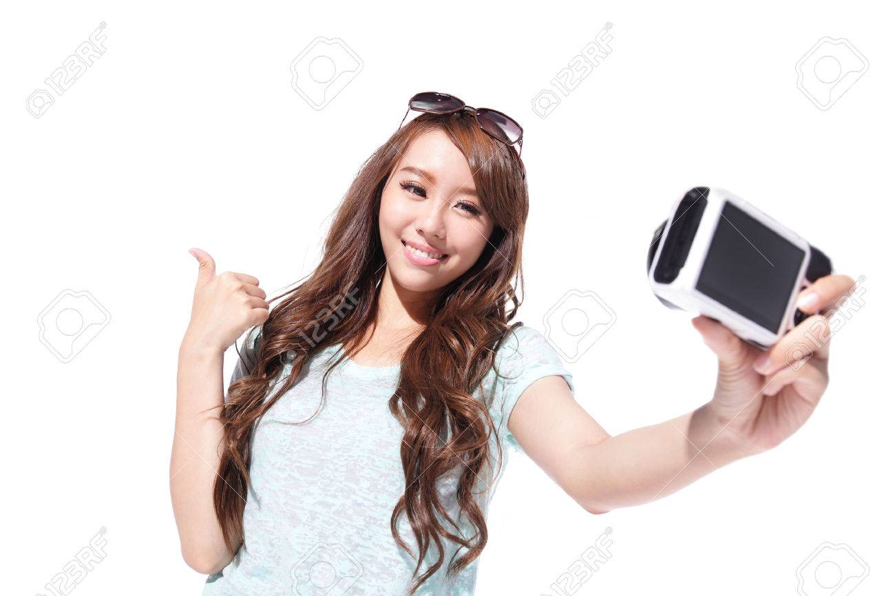 happy young woman taking selfie pictures of herself isolated stock