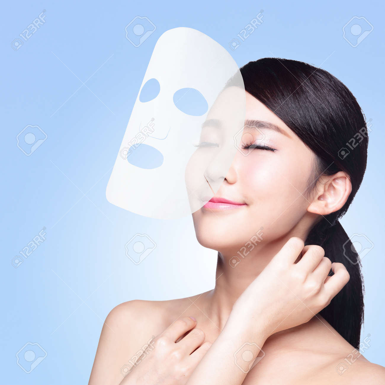 Relax Young Woman With Cloth Facial Mask Isolated On Blue Background Stock Photo Picture And Royalty Free Image Image 33423685