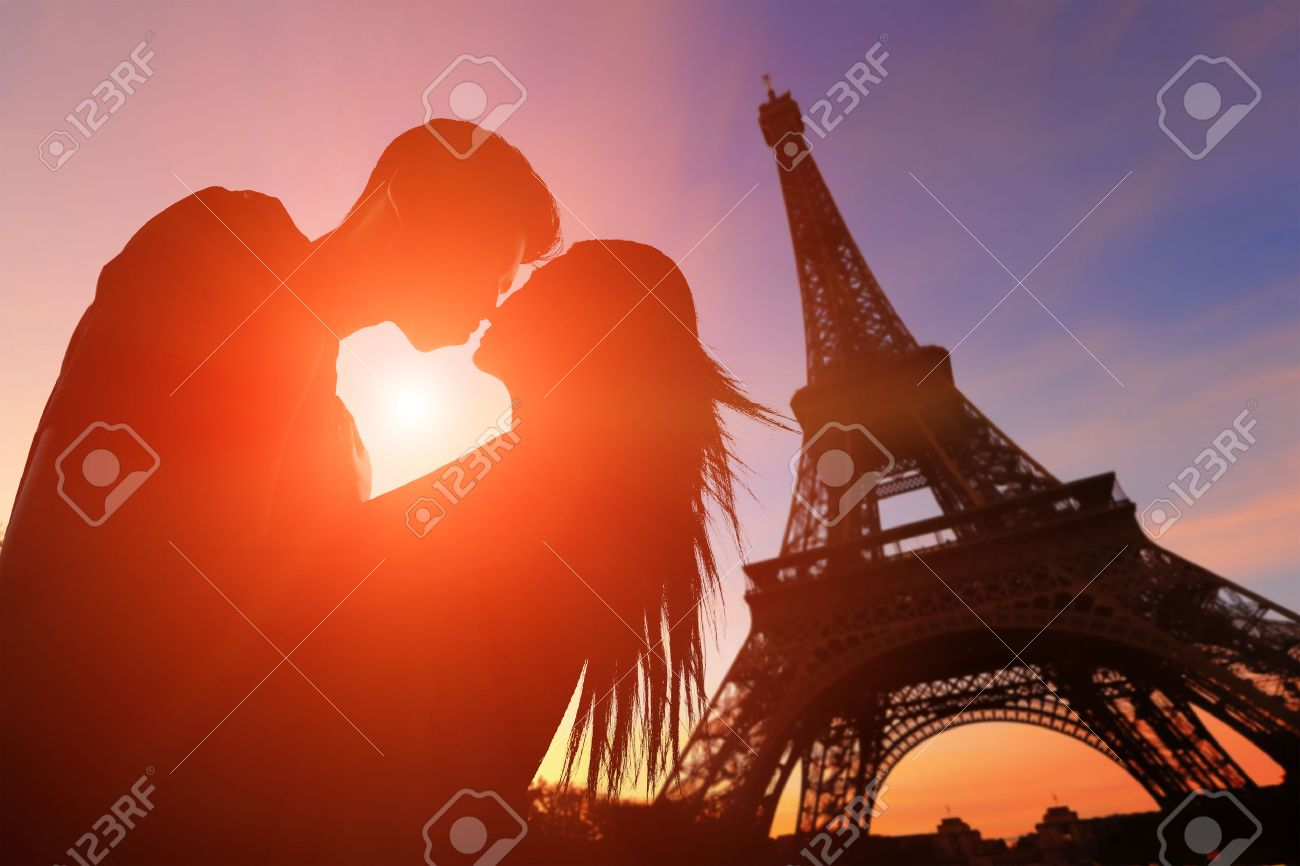 silhouette of romantic lovers with eiffel tower in paris with
