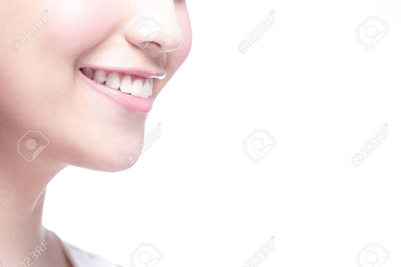 Beautiful young woman health teeth close up and charming smile. Isolated over white background - 44403524
