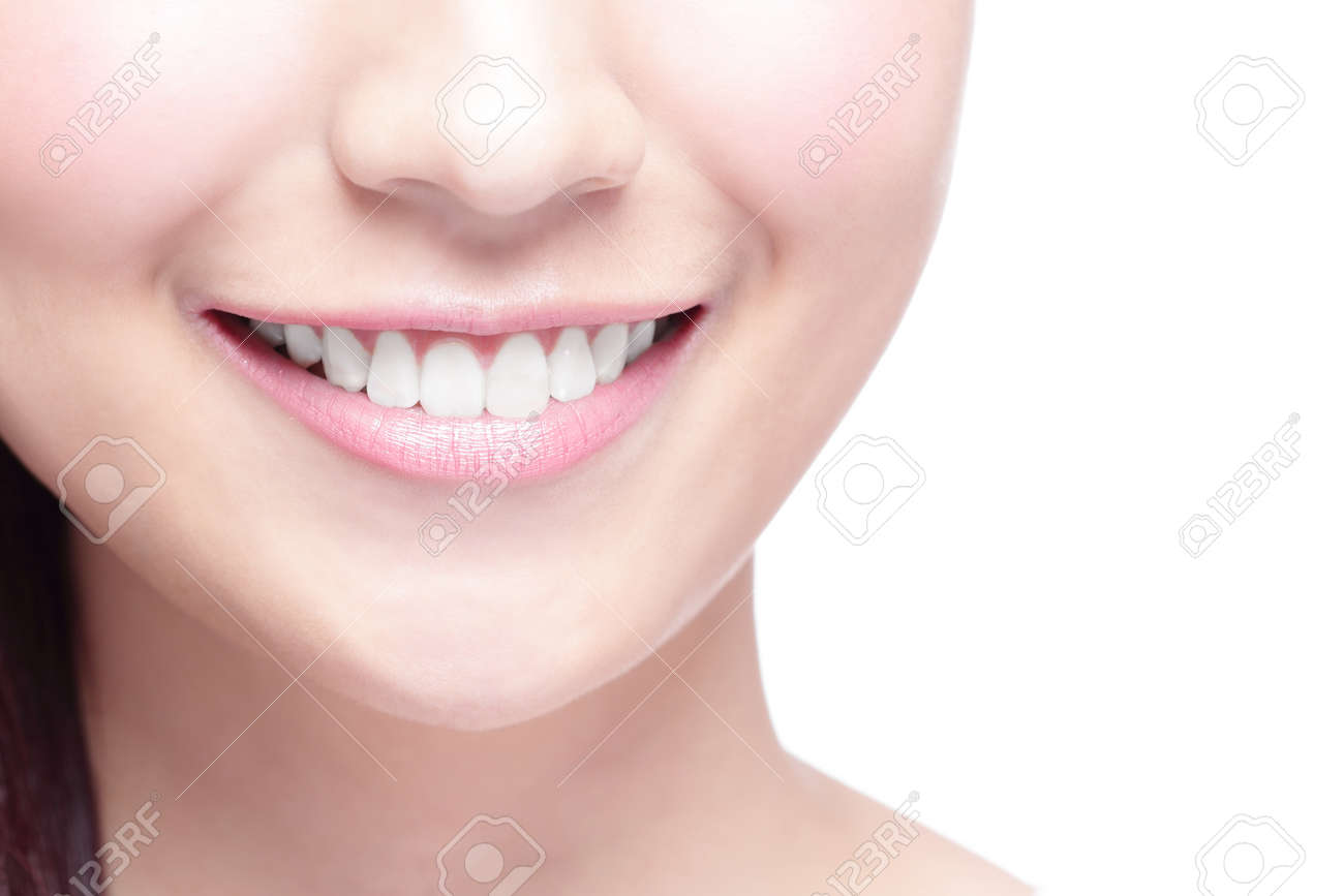 Beautiful young woman health teeth close up and charming smile. Isolated over white background, asian beauty - 48440866