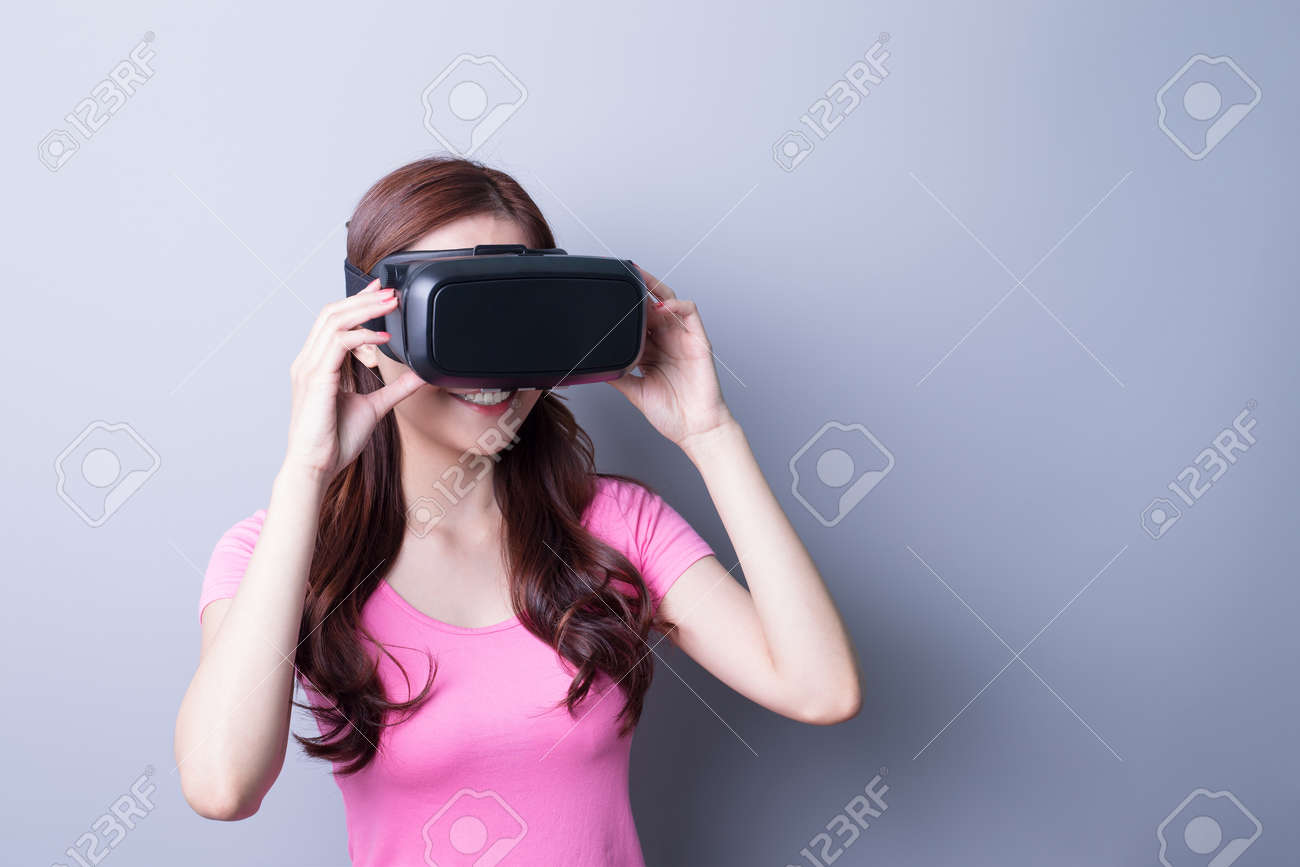 785eea6d03ee Smile happy woman getting experience using VR-headset glasses of virtual  reality at home much