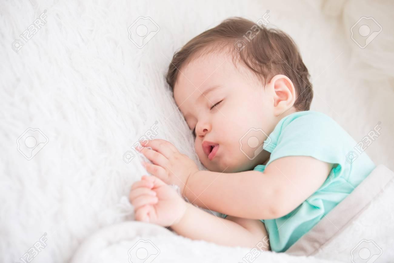 newborn cute baby sleeping. closeup portrait, caucasian child stock