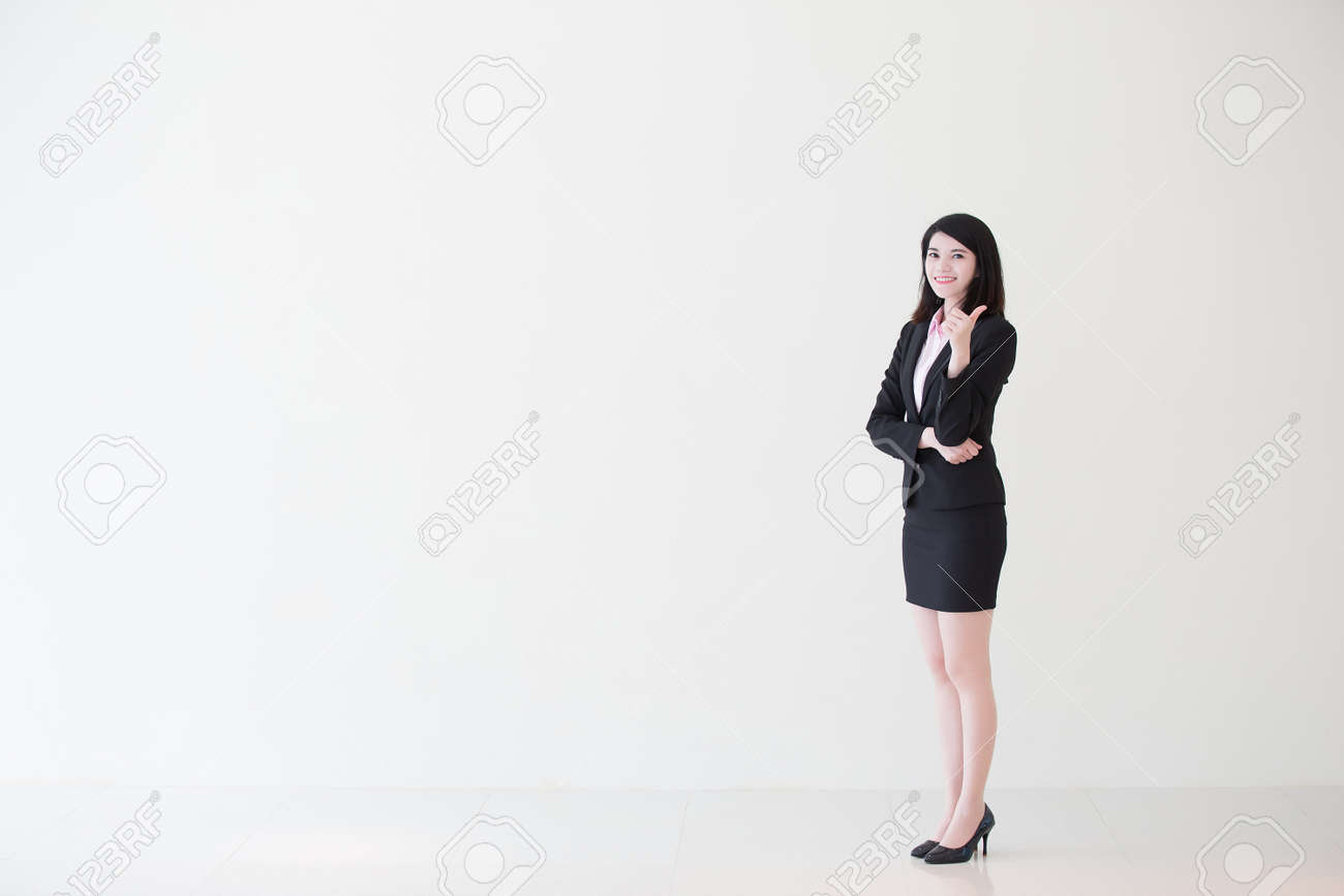 business woman show thumb up with white wall background, great for your design or text, asian - 59833619