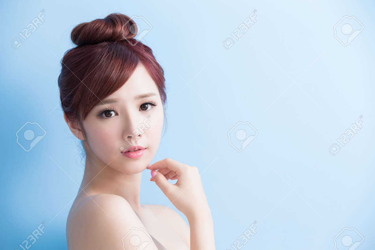 beauty  skin care woman smile to you isolated on bluebackground, asian Standard-Bild - 64951348