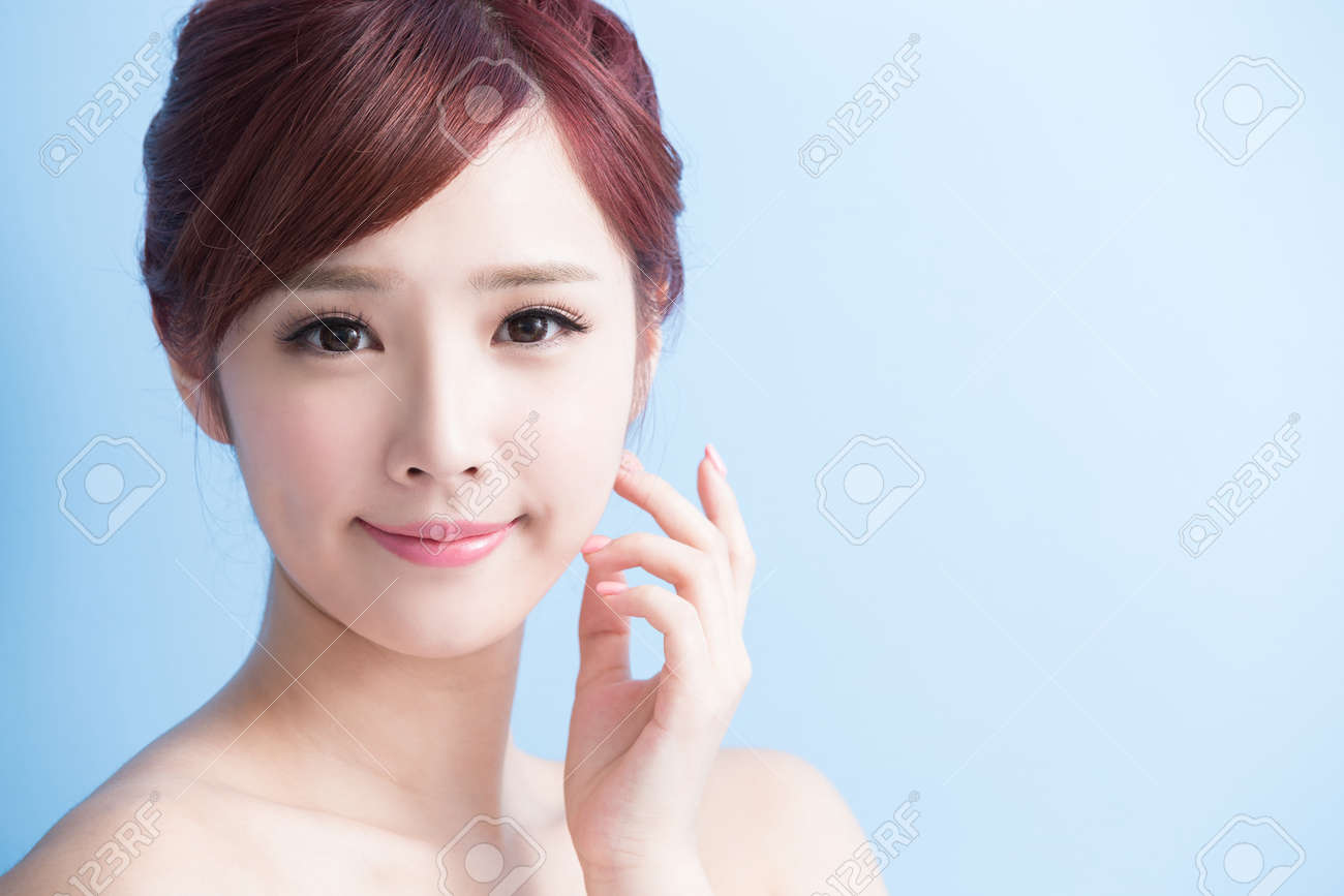 beauty woman smile to you isolated on bluebackground, asian Standard-Bild - 64951666