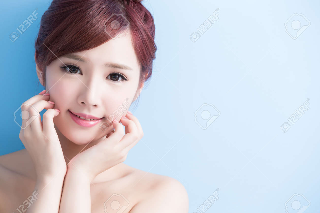 beauty  skin care woman smile to you isolated on bluebackground, asian Standard-Bild - 64960522