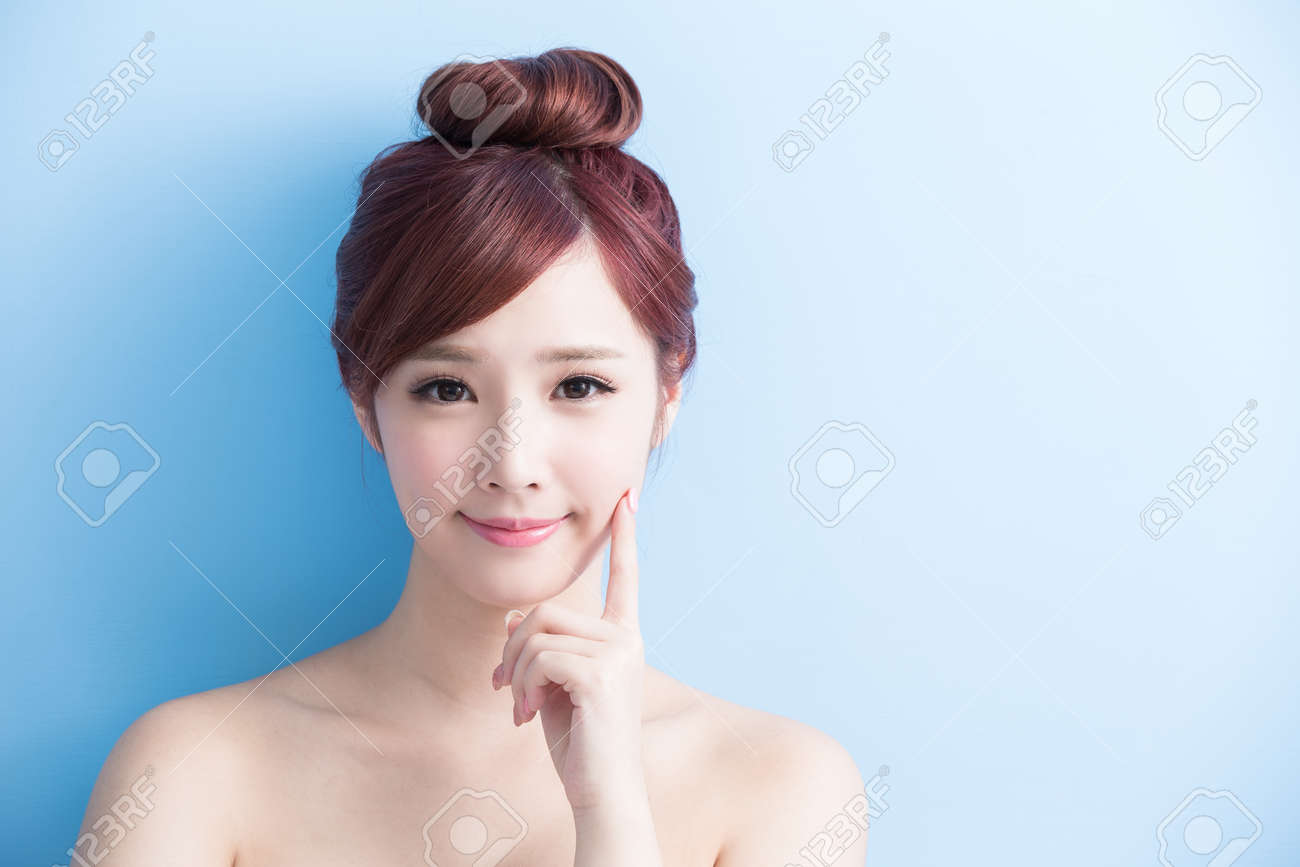 beauty woman smile to you isolated on bluebackground, asian Standard-Bild - 65008837