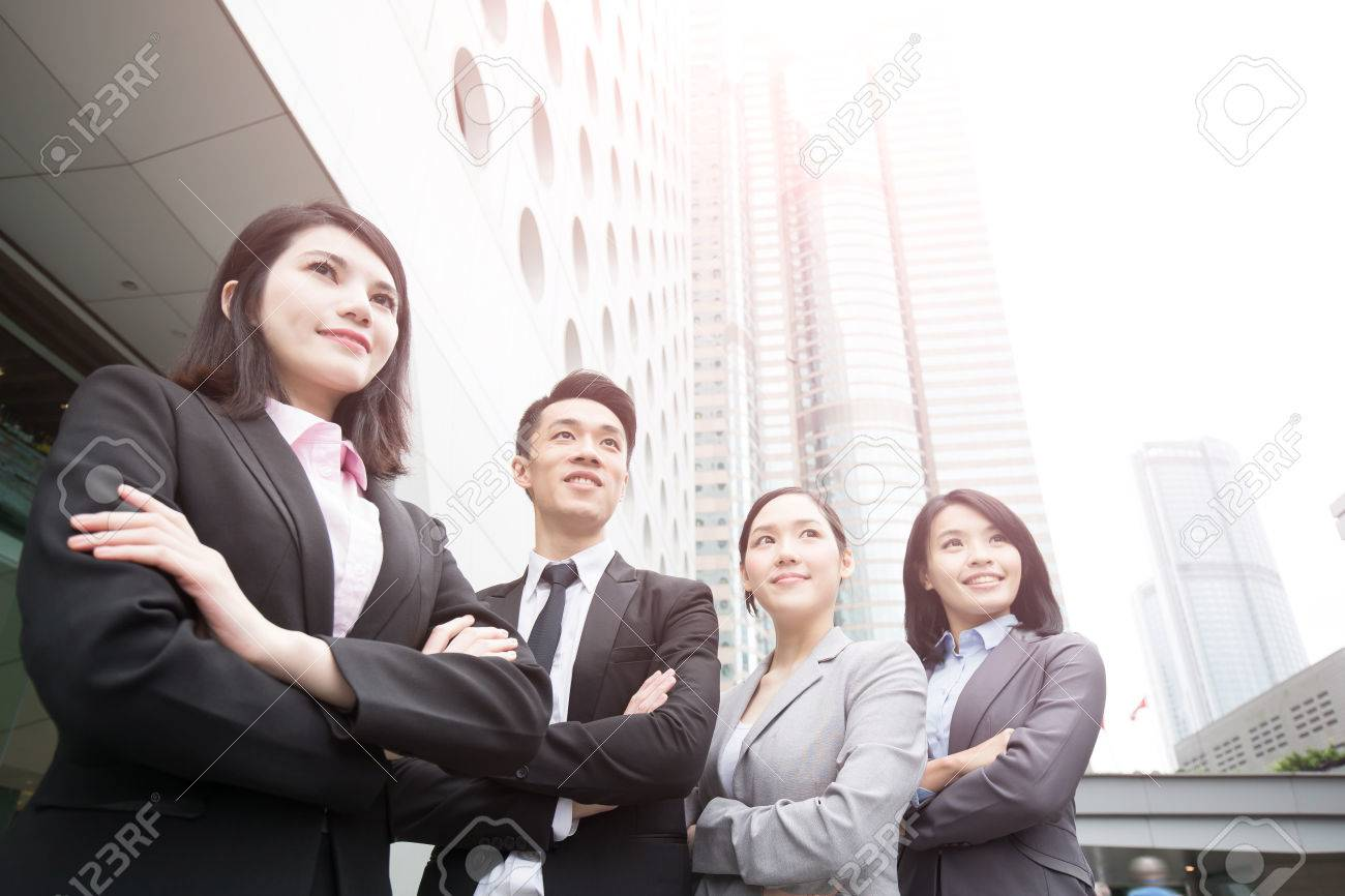 Business people team in the office, shot in Hong Kong, asian woman and man Standard-Bild - 64496040