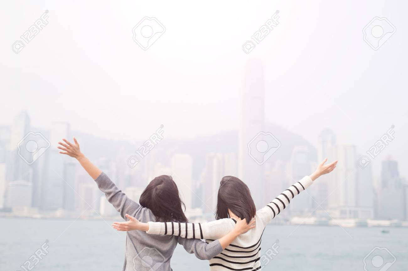 two beauty woman feel free and back to you in hongkong Standard-Bild - 65441232