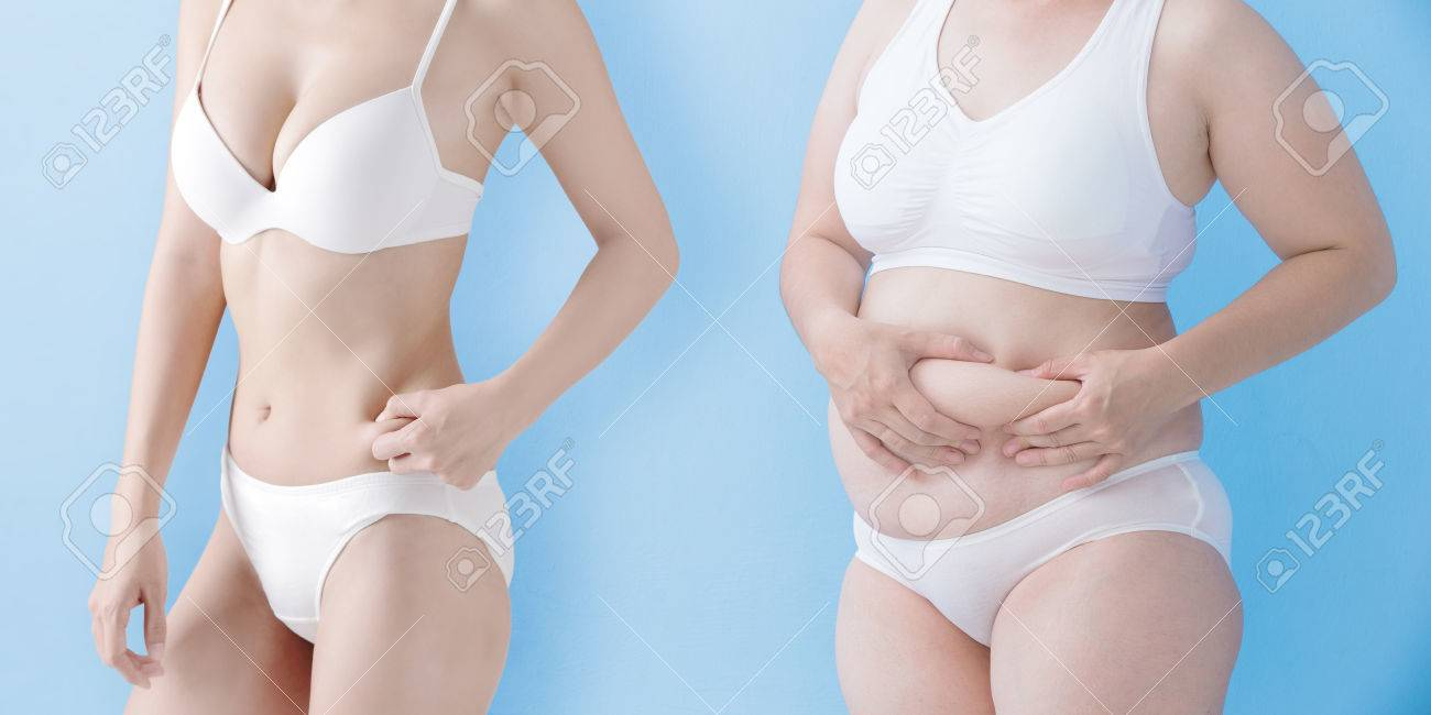 fat overweight woman and slim woman pinch their wait isolated on blue background, asian Standard-Bild - 66848623