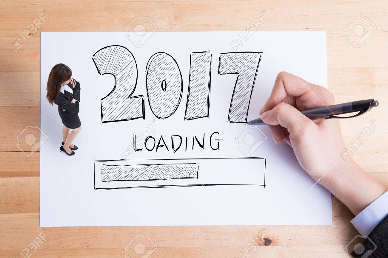 Writing A Business Paper  Business People Writing  New Year Loading Text On The Paper And Woman Look And Think About It Stock Photo