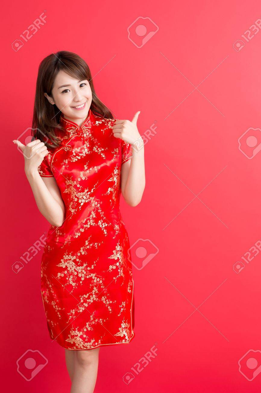 e9882d608 beauty woman wear cheongsam and thumb up with chinese new year Stock Photo  - 68109304