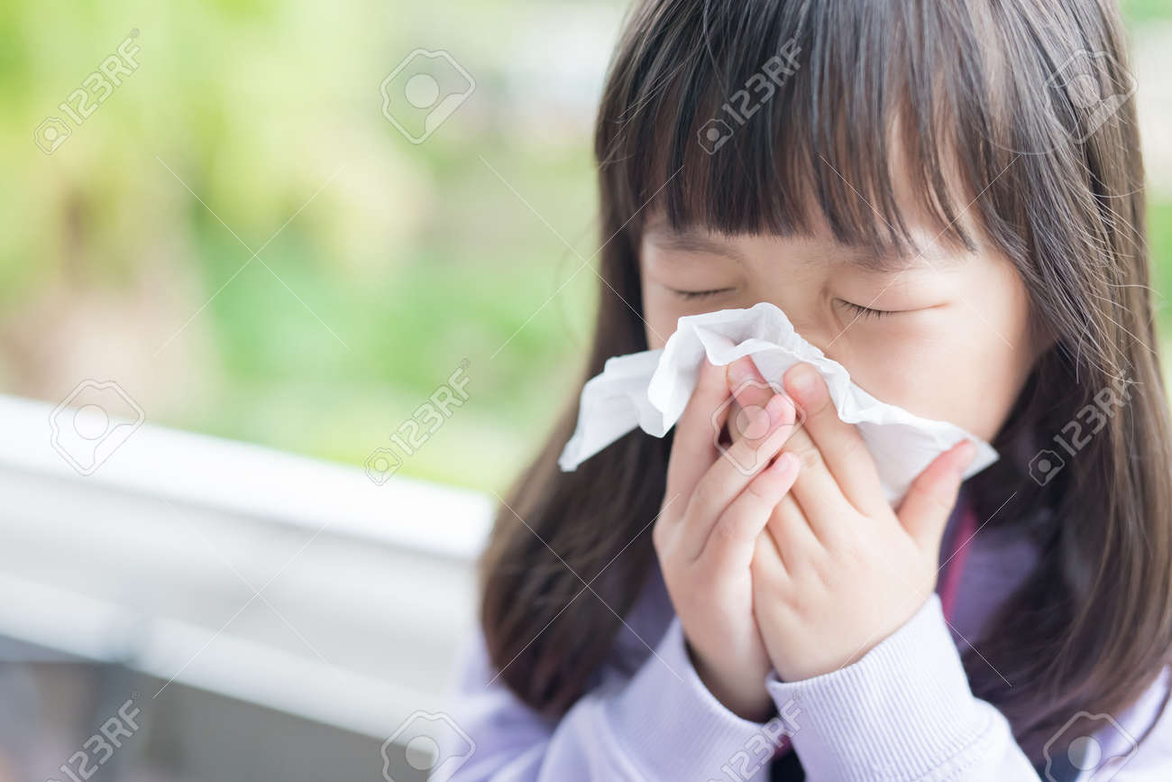 little girl get cold and blow her nose,  asian Standard-Bild - 71799841