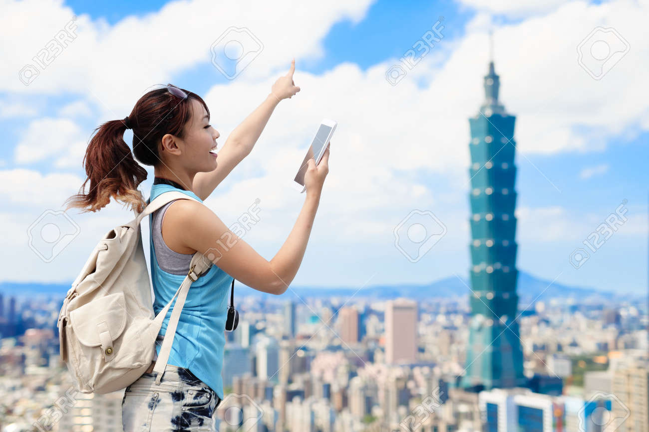 woman take phone and show something in the taipei - 88088033