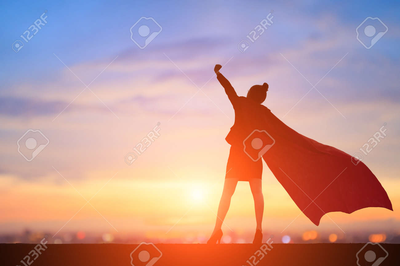 silhouette of super business woman feel excited with sunset - 95282080