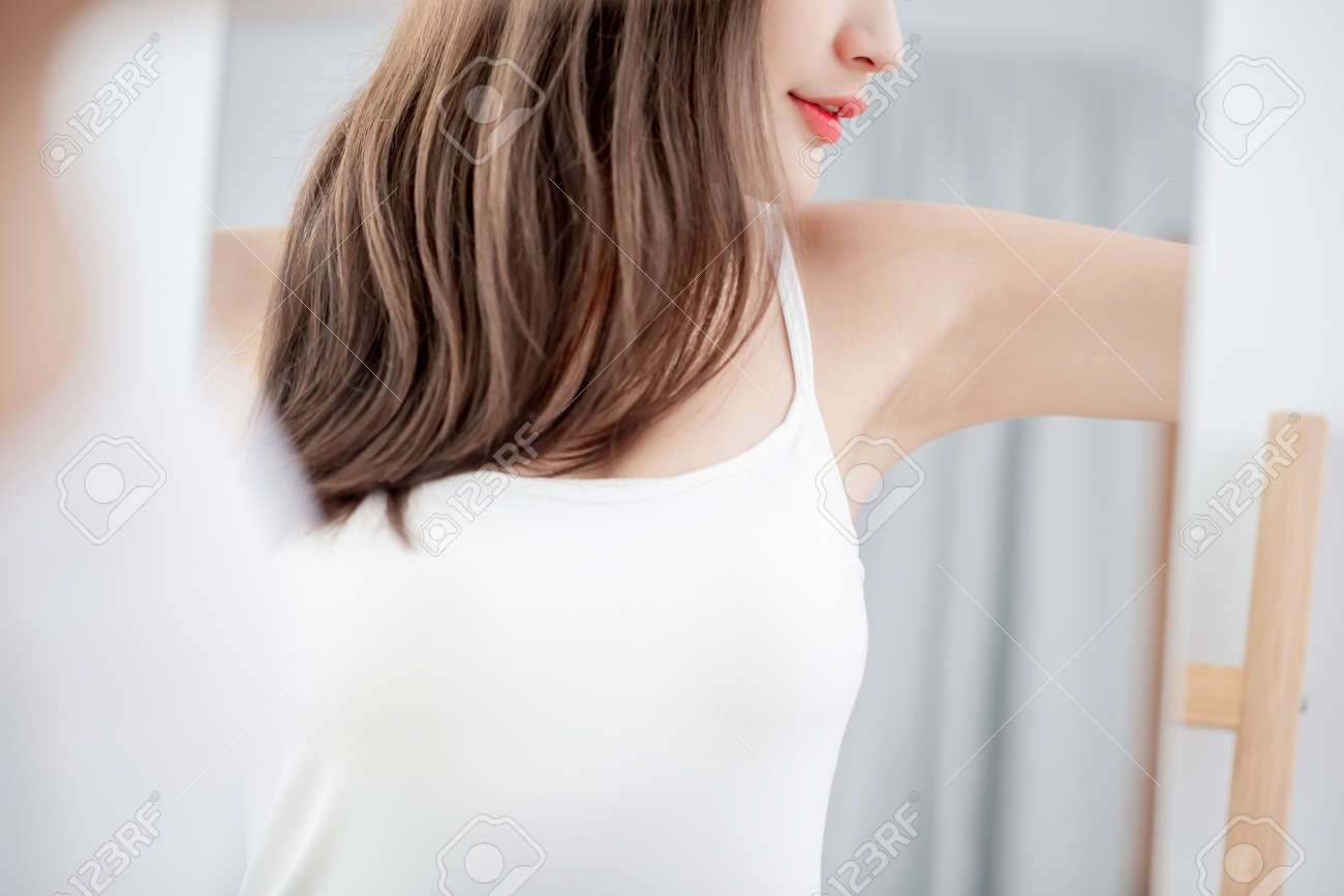 Young beauty woman smile with clean underarm in front of mirror - 121110955