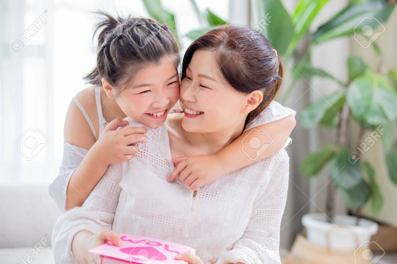 Happy mother day - daughter give card and gift to her mom at home - 121259796