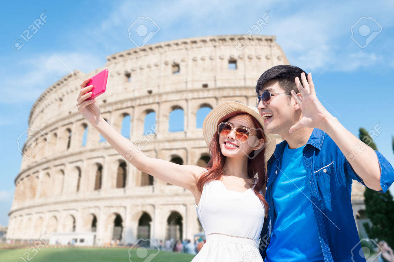 couple selfie happily with Colosseum in Italy - 122692128