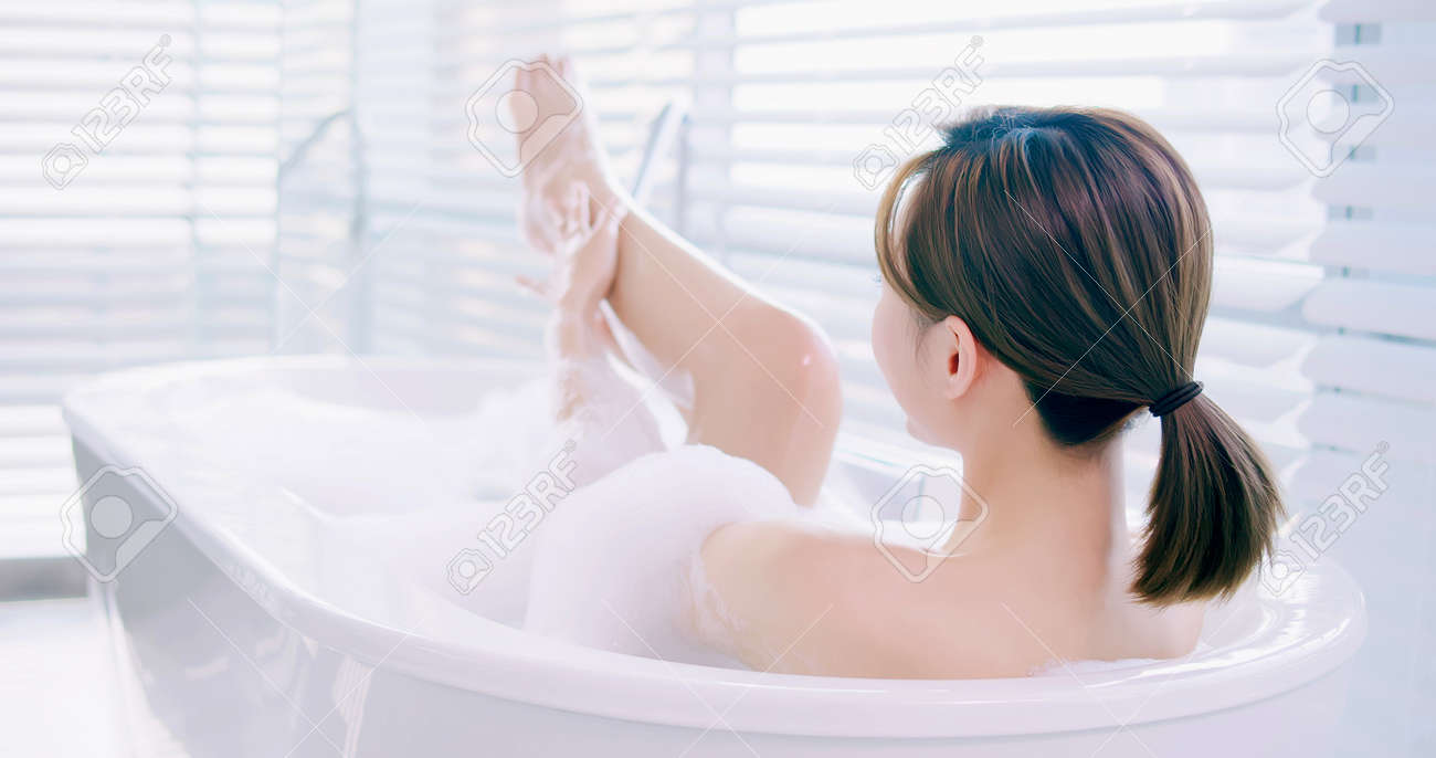 asian woman taking a bubble bath and touch her leg - 130673235