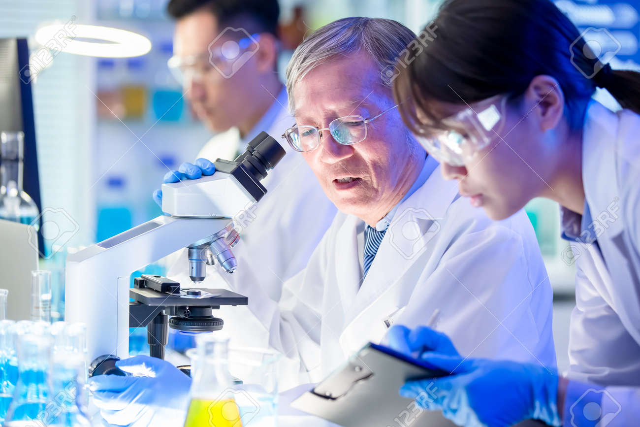 asian scientist team meeting and writing analysis results in the laboratory - 137311566