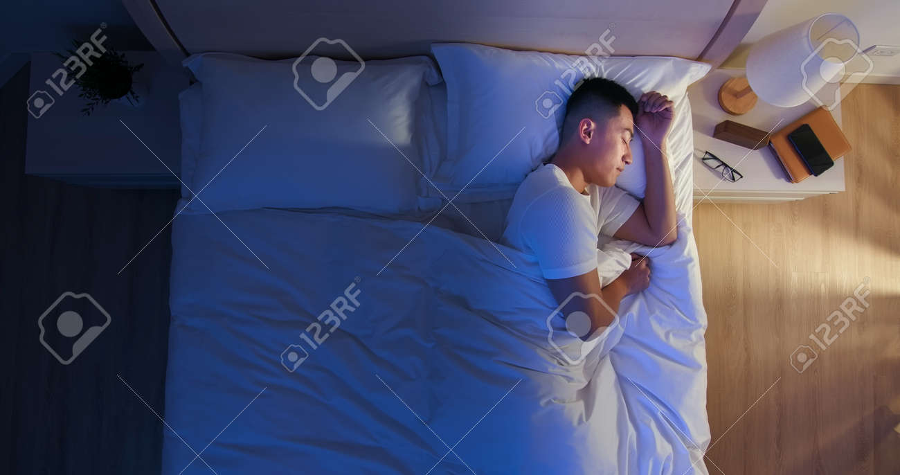 overlooking of asian man sleep well with smile at night - 147341826