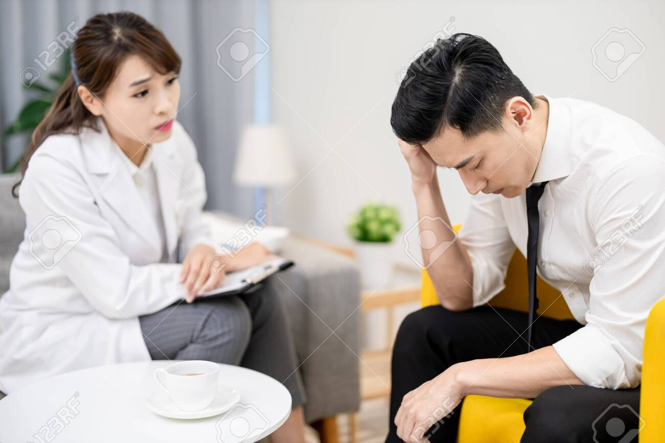 Asian female psychologist has consultation with male patient - 154157514
