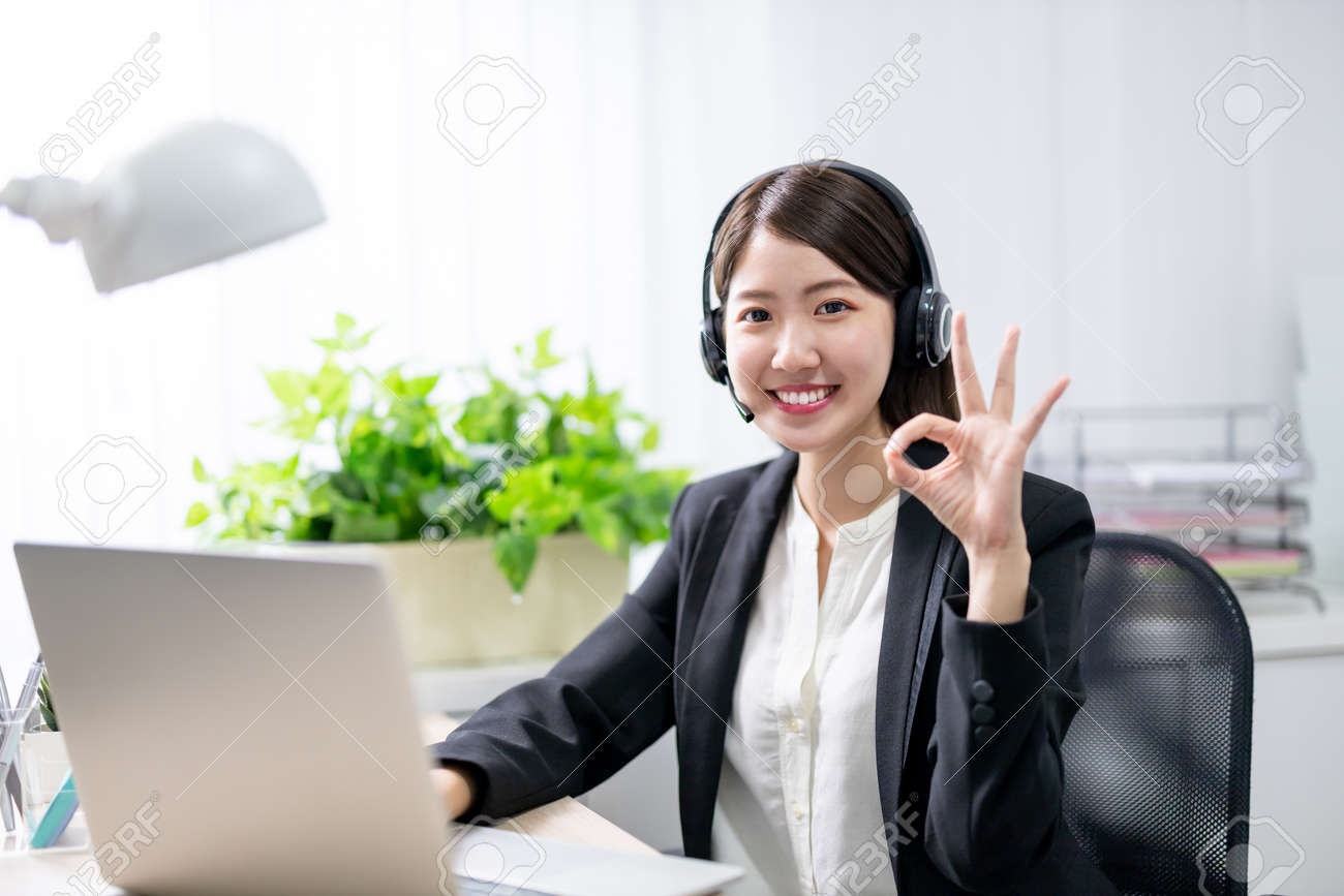 asian customer service representative working in the office - 155188188