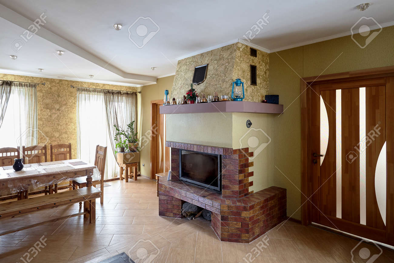 Fireplace And Table In Livingroom With Cups Lamps And Christmas