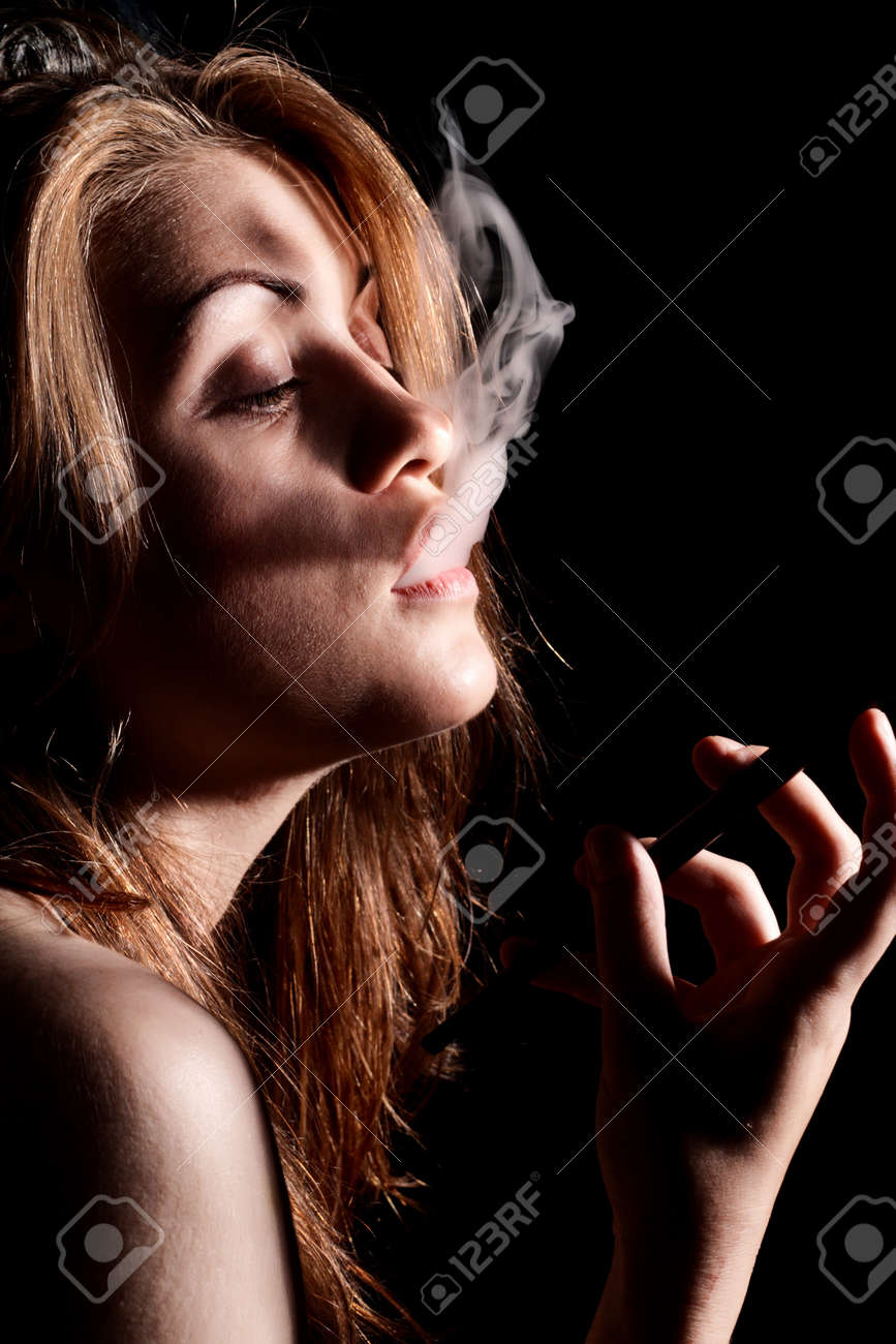 Young Women Smoke Cigarette Holder Stock Photo - 4083997