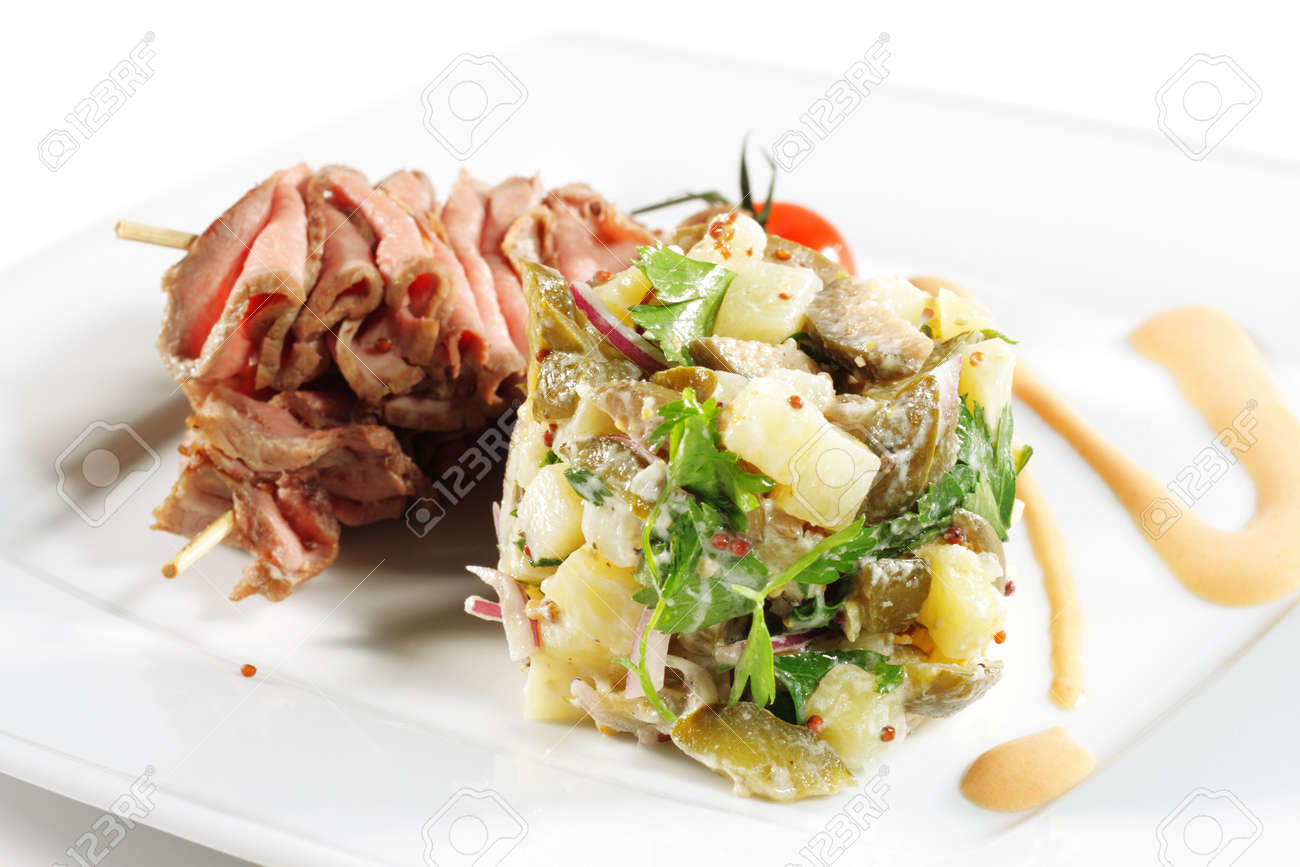 Roast Beef Served with Salad (Potatoes and Vegetables) and Cherry Tomato. Isolated on White Background Stock Photo - 4113315