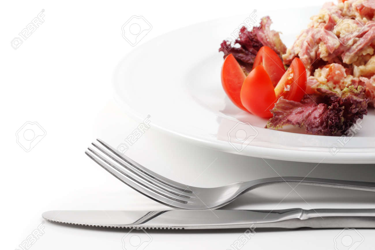 Salad Comprises Smoked Foods, Tomato and Cheese Dressed with Red Salad Leaves and Tomato. Isolated on White Background Stock Photo - 4123323