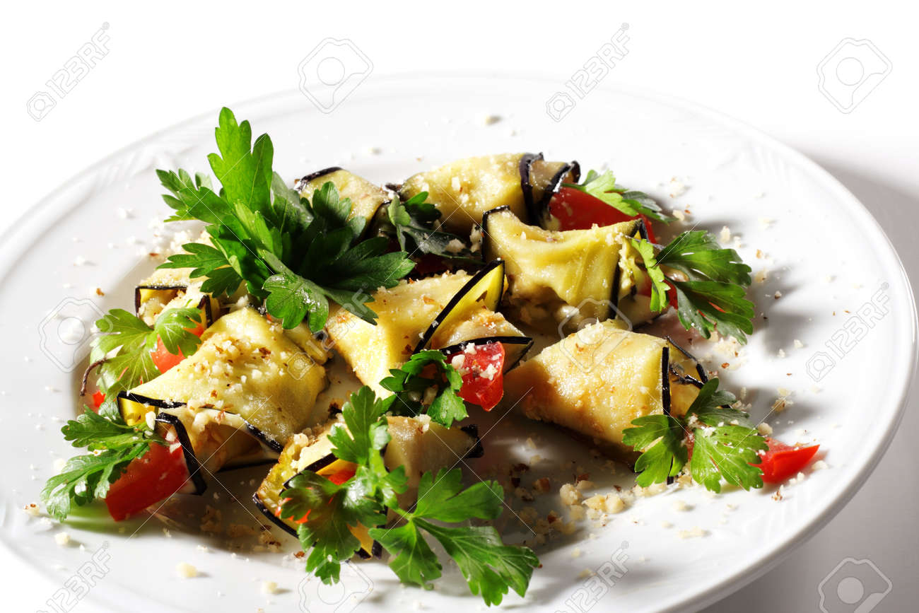 Baked Eggplant Plate Dressed with Parsley and Tomato. Isolated on White Background Stock Photo - 4167022