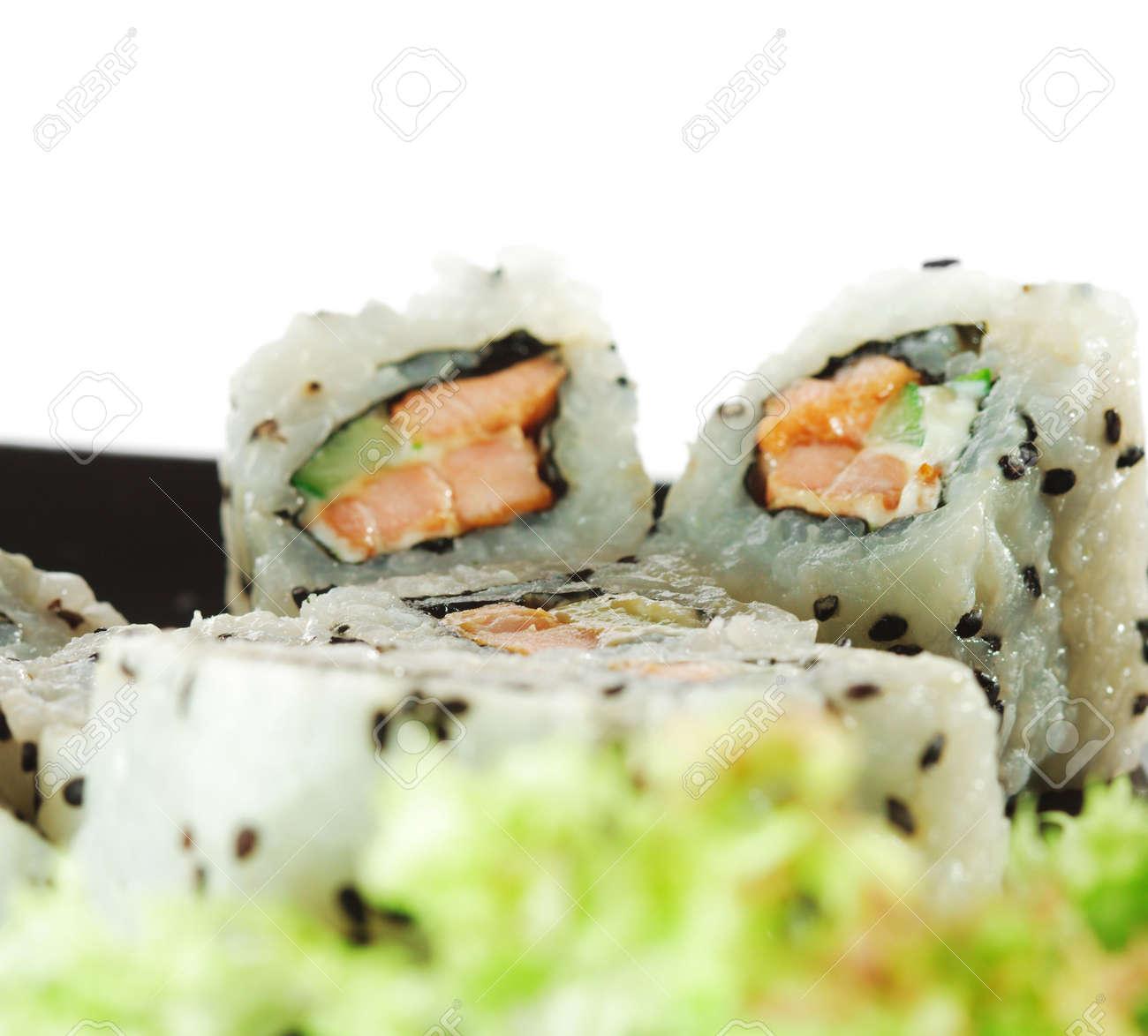 Japanese Cuisine - Sushi with Fresh Salad Leaf Stock Photo - 4958309