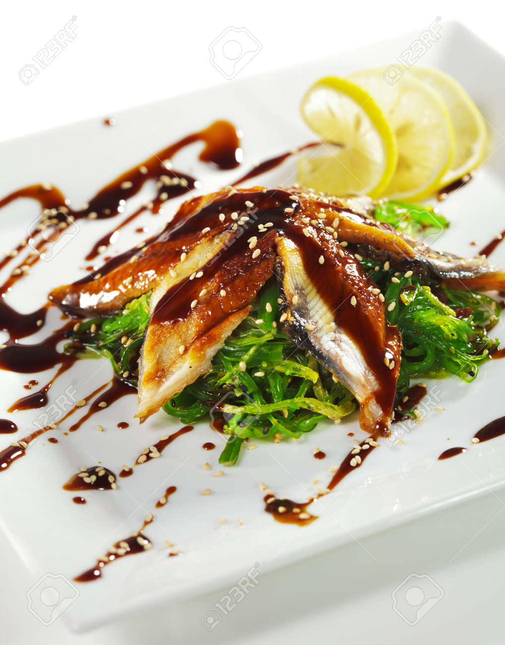 Japanese Cuisine - Chuka Seaweed and Unagi (smoked eel) Salad with Nuts Sauce. Topped with Eel Sauce and Sesame Stock Photo - 5925248