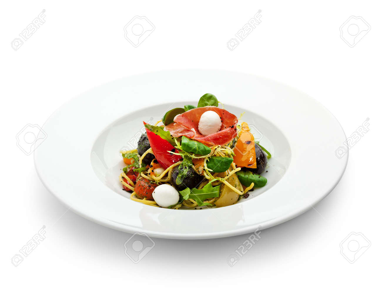 Spaghetti with Vegetables, Ham, Black Olives, Rucola and Pesto Sauce Stock Photo - 6781139