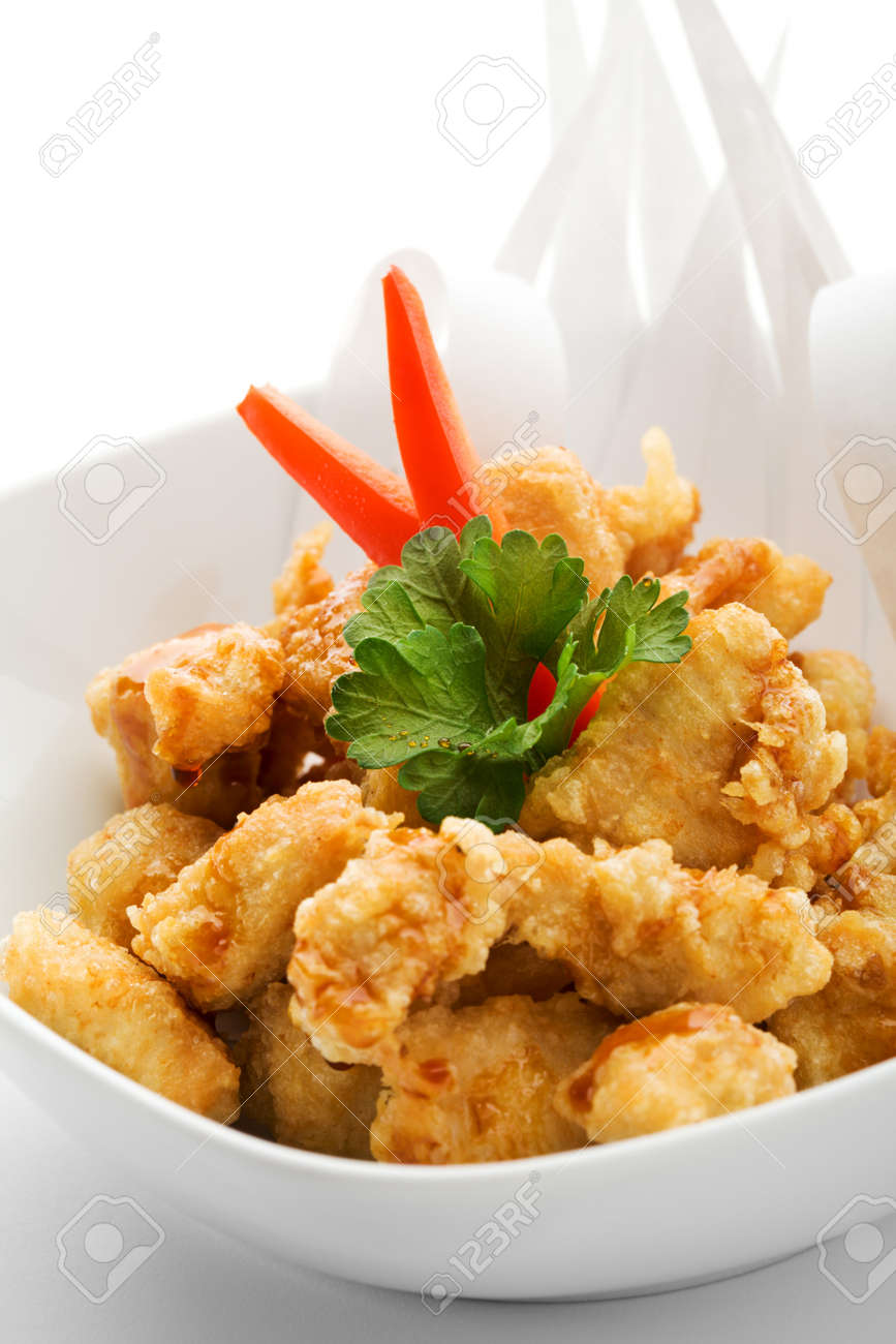Japanese Cuisine - Tempura Chicken (Deep Fried Chicken) with Parsley. Garnished with Paper Stock Photo - 7773014