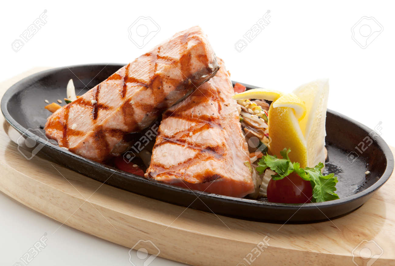 Grilled Foods - Salmon Steak with Vegetables. Garnished with Lemon and Parsley Stock Photo - 7773338