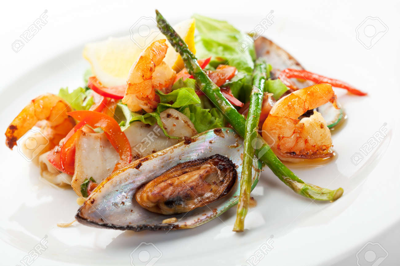 Fried Seafood Salad with Lemon Slice and Asparagus Stock Photo - 7915644