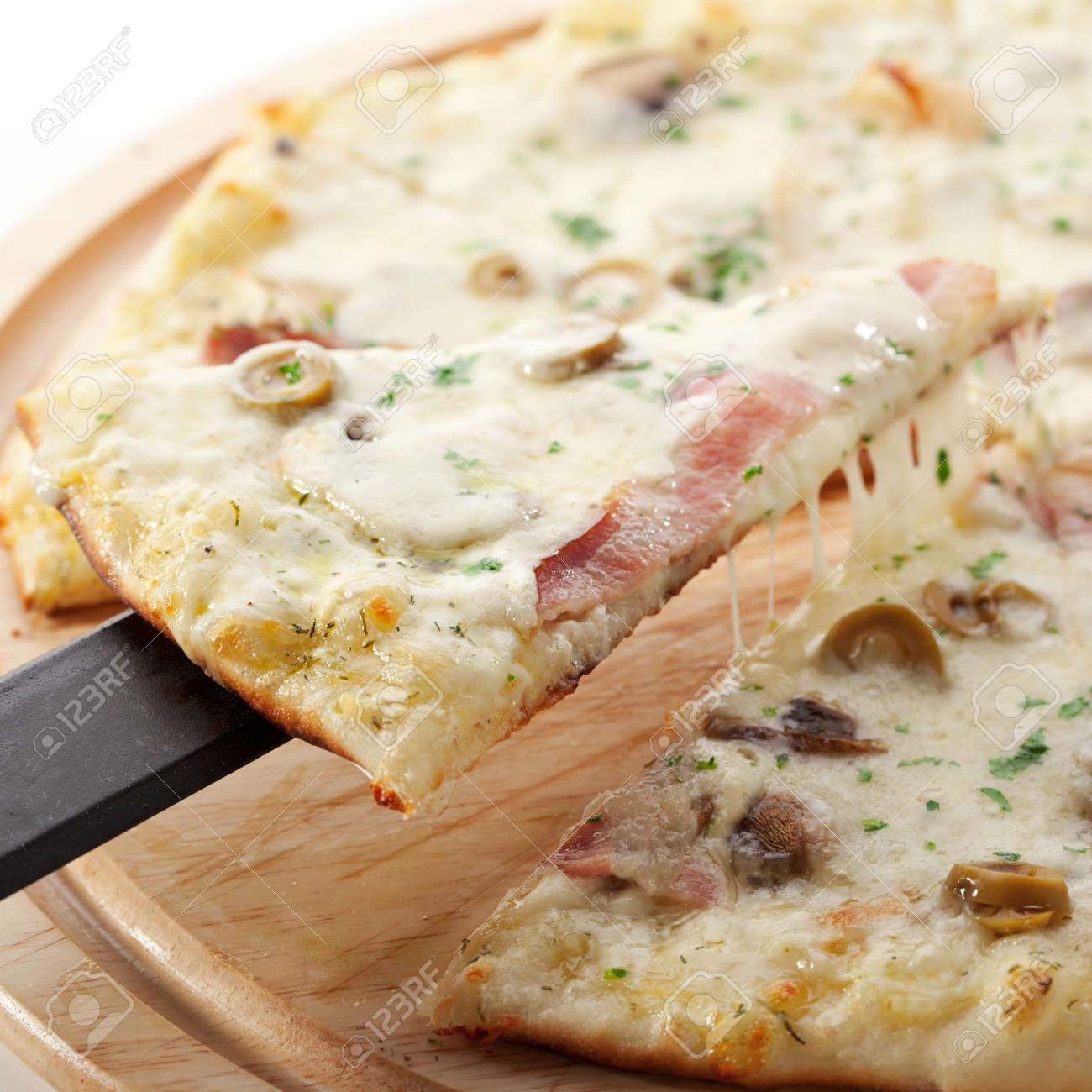 White Pizza Made From Sour Cream Sauce, Mushrooms, Ham And