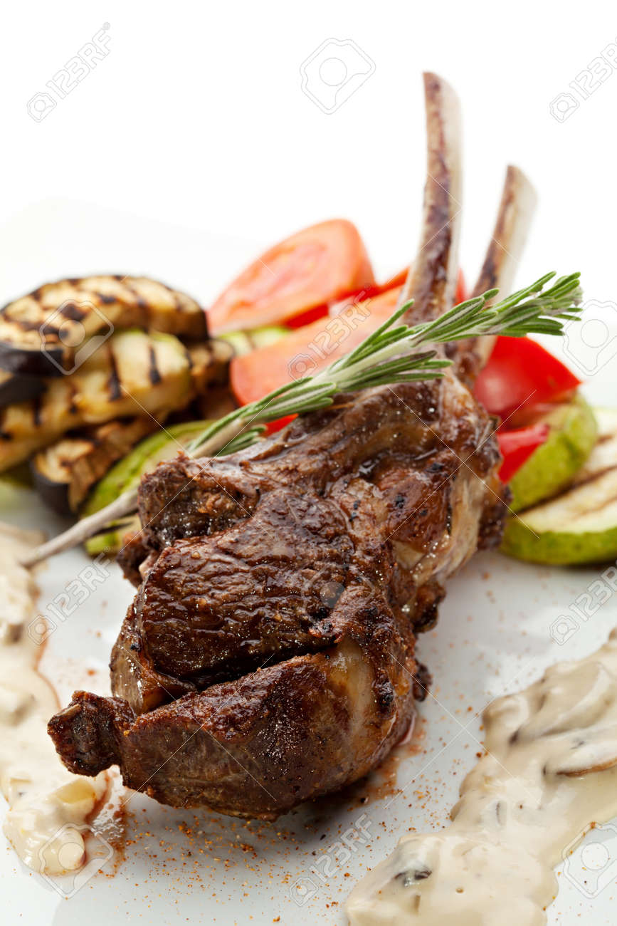 grilled rack of lamb with mushrooms sauce and bbq vegetables stock