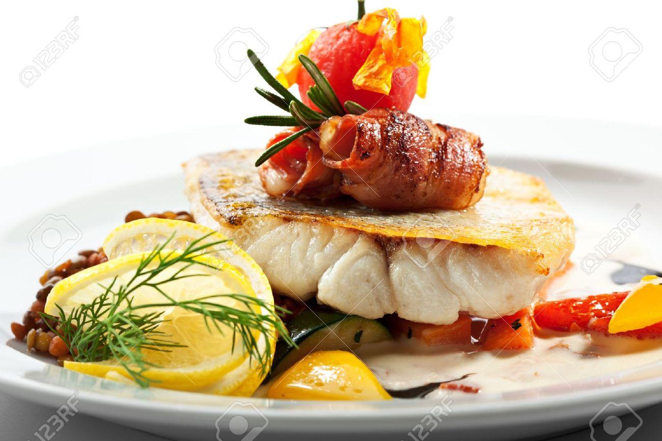 Fried Fish (Zander) with Bacon. Garnished with Lemon, Lentil and Vegetables - 21457506