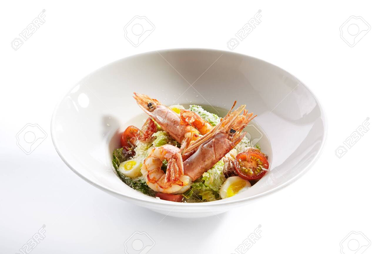 Delicious caesar with argentinian shrimps closeup. North american cuisine restaurant dish, menu item. Tasty salad with natural seafood isolated on white background. Organic lunch, healthy food - 131353827