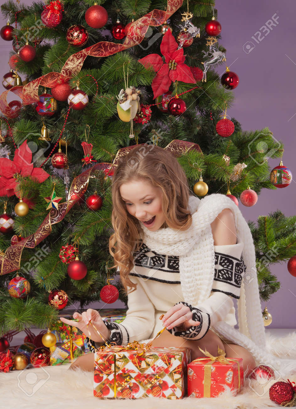 Girl with gift boxes near christmas tree Stock Photo - 17008831