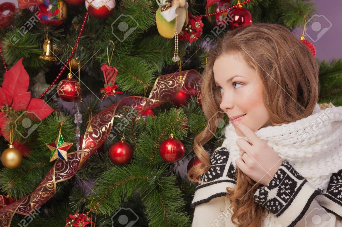 Beautiful woman hanging toy on Christmas tree Stock Photo - 17008833