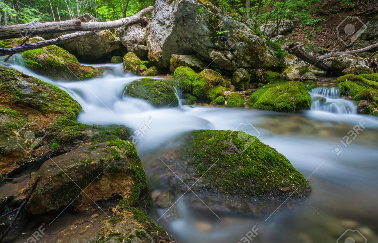 Mountain river. A stream of water in forest and mountain terrain. Crimea, the Grand Canyon. Stock Photo - 18009220